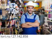 Купить «Man artisan with folded arms in paint store», фото № 27142858, снято 13 сентября 2017 г. (c) Яков Филимонов / Фотобанк Лори