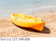 Купить «close-up of a yellow kayak at the water's edge on the sandy beach of Thailand», фото № 27144606, снято 8 ноября 2016 г. (c) Константин Лабунский / Фотобанк Лори