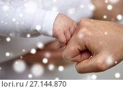 Купить «close up of mother and newborn baby hands», фото № 27144870, снято 23 ноября 2016 г. (c) Syda Productions / Фотобанк Лори