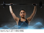 Купить «young woman flexing muscles with barbell in gym», фото № 27144946, снято 12 декабря 2015 г. (c) Syda Productions / Фотобанк Лори