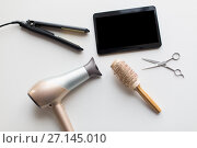 Купить «tablet pc, scissors, hairdryer, hot iron and brush», фото № 27145010, снято 12 апреля 2017 г. (c) Syda Productions / Фотобанк Лори