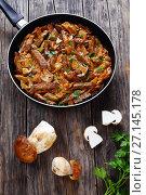 Купить «tasty veal strips stewed with porcini», фото № 27145178, снято 19 декабря 2018 г. (c) Oksana Zh / Фотобанк Лори