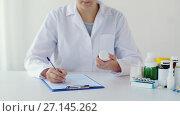 Купить «doctor with medicine and clipboard at hospital», видеоролик № 27145262, снято 20 июля 2018 г. (c) Syda Productions / Фотобанк Лори