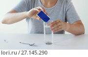 Купить «woman stirring medication in glass of water», видеоролик № 27145290, снято 20 июля 2018 г. (c) Syda Productions / Фотобанк Лори
