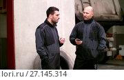 Купить «auto mechanics at smoking break talking outdoor», видеоролик № 27145314, снято 6 октября 2017 г. (c) Syda Productions / Фотобанк Лори