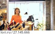Купить «happy young woman choosing shoes at store», видеоролик № 27145666, снято 6 октября 2017 г. (c) Syda Productions / Фотобанк Лори