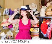 Купить «Woman choose natural hat in shop», фото № 27145942, снято 2 мая 2017 г. (c) Яков Филимонов / Фотобанк Лори