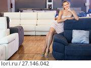 Купить «Portrait of woman consumer choosing sofa in furniture shop», фото № 27146042, снято 5 сентября 2017 г. (c) Яков Филимонов / Фотобанк Лори