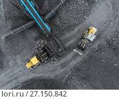 Купить «Open pit mine, breed sorting. Mining coal. Bulldozer sorts coal. Extractive industry, anthracite. Crushing marshalling complex. Coal industry.», фото № 27150842, снято 8 сентября 2017 г. (c) Сергей Тимофеев / Фотобанк Лори