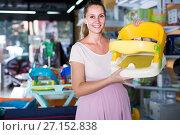 Купить «cheerful pregnant woman choosing chair for feeding baby at infant shop», фото № 27152838, снято 22 сентября 2017 г. (c) Яков Филимонов / Фотобанк Лори