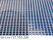 Купить «Фон из окон современного офисного высотного здания небоскреба», фото № 27153326, снято 16 октября 2017 г. (c) Наталья Волкова / Фотобанк Лори