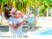 Купить «Tourist woman with sea turtle in the hands in exotic reserve», фото № 27153986, снято 10 апреля 2017 г. (c) Дмитрий Травников / Фотобанк Лори