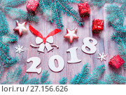 Купить «Happy New Year 2018 background with 2017 figures, Christmas toys, blue fir tree branches. New Year 2018 composition», фото № 27156626, снято 29 ноября 2016 г. (c) Зезелина Марина / Фотобанк Лори