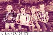 Купить «Positive kids posing together outdoor», фото № 27157178, снято 20 июня 2018 г. (c) Яков Филимонов / Фотобанк Лори