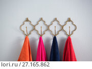 Купить «Colorful towels hanging on hook», фото № 27165862, снято 25 августа 2017 г. (c) Wavebreak Media / Фотобанк Лори