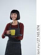 Купить «Waitress holding a tray of coffee cup against white background», фото № 27165974, снято 25 августа 2017 г. (c) Wavebreak Media / Фотобанк Лори