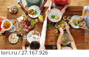 Купить «group of people eating at table with food», видеоролик № 27167926, снято 23 апреля 2019 г. (c) Syda Productions / Фотобанк Лори