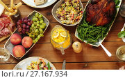 Купить «group of people eating at table with food», видеоролик № 27167934, снято 15 сентября 2019 г. (c) Syda Productions / Фотобанк Лори