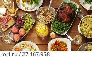 Купить «group of people eating at table with food», видеоролик № 27167958, снято 15 сентября 2019 г. (c) Syda Productions / Фотобанк Лори