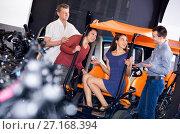 Купить «Male employee helping family to select tour electrics», фото № 27168394, снято 16 октября 2018 г. (c) Яков Филимонов / Фотобанк Лори