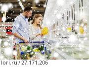 Купить «couple with shopping cart buying food at grocery», фото № 27171206, снято 21 октября 2016 г. (c) Syda Productions / Фотобанк Лори