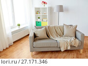 Купить «sofa with cushions at cozy home living room», фото № 27171346, снято 19 мая 2017 г. (c) Syda Productions / Фотобанк Лори
