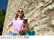 Купить «happy teenage girl with longboard and smartphone», фото № 27171494, снято 17 июня 2017 г. (c) Syda Productions / Фотобанк Лори
