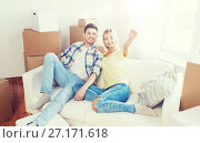 Купить «couple with boxes moving to new home and dreaming», фото № 27171618, снято 25 февраля 2016 г. (c) Syda Productions / Фотобанк Лори