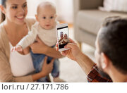 Купить «happy family with baby photographing at home», фото № 27171786, снято 29 сентября 2017 г. (c) Syda Productions / Фотобанк Лори