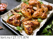 Купить «Roasted chicken wings», фото № 27171874, снято 26 сентября 2017 г. (c) Татьяна Волгутова / Фотобанк Лори