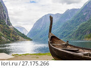 Купить «Beautiful view of Viking drakkar at the end of the Sognefjord between Flam and Gudvangen in Norway», фото № 27175266, снято 26 июля 2017 г. (c) Алексей Ширманов / Фотобанк Лори