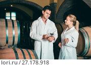 Купить «Specialists checking ageing process of wine», фото № 27178918, снято 21 сентября 2016 г. (c) Яков Филимонов / Фотобанк Лори