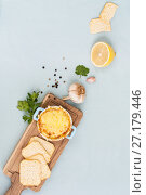 Купить «Eggplant mousse, baked under a cheese crust and ingredients on a wooden board.», фото № 27179446, снято 3 ноября 2017 г. (c) Olesya Tseytlin / Фотобанк Лори