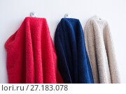 Купить «Colorful towels hanging on hook», фото № 27183078, снято 25 августа 2017 г. (c) Wavebreak Media / Фотобанк Лори