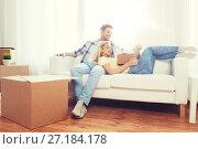 Купить «happy couple with big cardboard boxes at new home», фото № 27184178, снято 25 февраля 2016 г. (c) Syda Productions / Фотобанк Лори