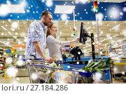 Купить «couple buying food at grocery self-checkout», фото № 27184286, снято 21 октября 2016 г. (c) Syda Productions / Фотобанк Лори