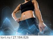 Купить «young woman body in gym», фото № 27184826, снято 12 декабря 2015 г. (c) Syda Productions / Фотобанк Лори