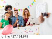 Купить «friends or team photographing at office party», фото № 27184978, снято 3 сентября 2017 г. (c) Syda Productions / Фотобанк Лори