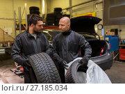 Купить «auto mechanics changing car tires at workshop», фото № 27185034, снято 21 сентября 2017 г. (c) Syda Productions / Фотобанк Лори