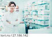 Купить «Female pharmacist arranging displayed assortment», фото № 27186142, снято 31 января 2017 г. (c) Яков Филимонов / Фотобанк Лори