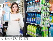 Купить «Young female shopper searching for cleaners», фото № 27186178, снято 23 ноября 2016 г. (c) Яков Филимонов / Фотобанк Лори