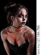 Купить «Young woman with a Halloween makeup», фото № 27186786, снято 28 октября 2017 г. (c) Art Konovalov / Фотобанк Лори
