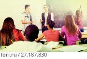 Купить «Students and teacher in class», фото № 27187830, снято 23 мая 2019 г. (c) Яков Филимонов / Фотобанк Лори