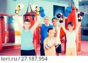Купить «Boys and girl posing with coach in fighting stance», фото № 27187954, снято 12 апреля 2017 г. (c) Яков Филимонов / Фотобанк Лори