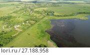 Купить «View from quadrocopter to village with pond in Russia», видеоролик № 27188958, снято 20 августа 2019 г. (c) Володина Ольга / Фотобанк Лори