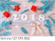 Купить «New Year 2018 background with 2018 figures,Christmas toys, fir tree branches», фото № 27191002, снято 29 ноября 2016 г. (c) Зезелина Марина / Фотобанк Лори
