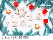 Купить «New Year 2018 background with 2018 figures,Christmas toys, fir branches - New Year 2018 composition», фото № 27191006, снято 30 ноября 2016 г. (c) Зезелина Марина / Фотобанк Лори