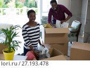 Купить «Happy couple unpacking boxes», фото № 27193478, снято 31 августа 2017 г. (c) Wavebreak Media / Фотобанк Лори