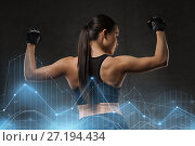 Купить «young woman flexing muscles in gym», фото № 27194434, снято 12 декабря 2015 г. (c) Syda Productions / Фотобанк Лори