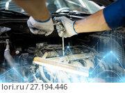 Купить «mechanic man with wrench repairing car at workshop», фото № 27194446, снято 1 июля 2016 г. (c) Syda Productions / Фотобанк Лори